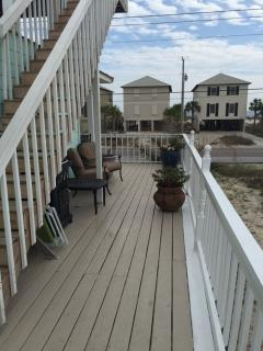 Side porch and stairs leading to the top deck