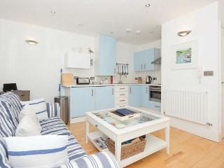 Modern, pale blue corner kitchen area
