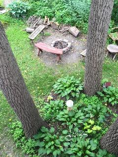 Private fire pit in back yard as seen from balcony.