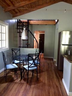 Dining area with spiral staircase to loft.