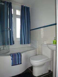 Enjoy a bath or shower in the newly fitted bathroom