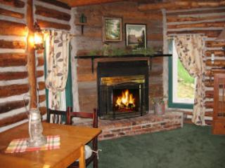 Spend time by the cozy wood burning fireplace, firewood is sold separately