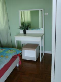 Dressing table in second bedroom, wardrobe out of view.