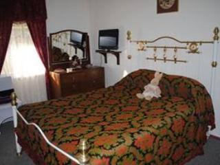 Outside room, queen bed with T.V.