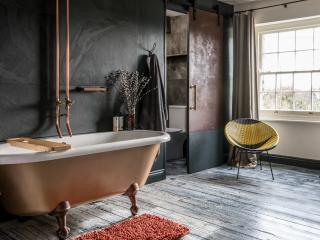 Bedroom 2 with freestanding bath & ensuite