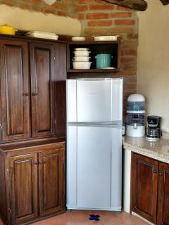 The kitchen is spacious and generously equipped.