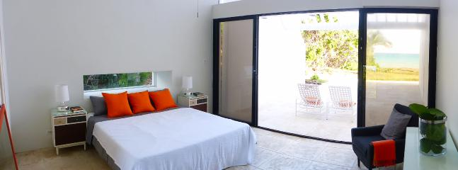 Master Bedroom with private patio and view onto the ocean.