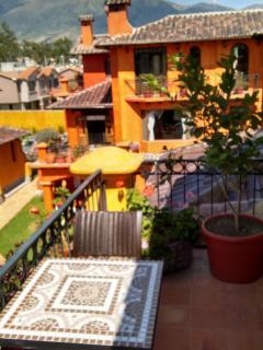 Veranda off master bedroom. Great views of volcano Cotacachi and the courtyard area.