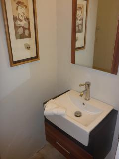 Bathroom with tub/shower shared by 3rd and 4th bedrooms