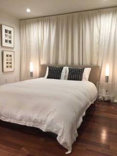 Silk Curtains line the back of the bed wall for an even warmer sleeping experience