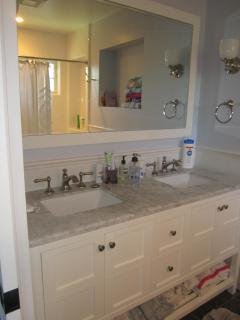 Lower Level full bathroom with 2 sinks.