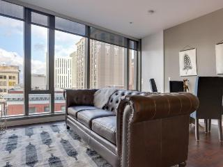 Elegant, dog-friendly downtown condo with wrap-around views!