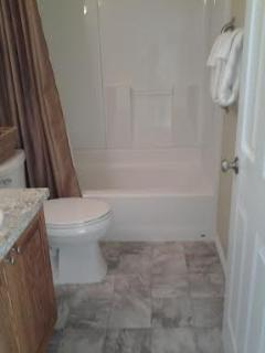 New Clean Bright Full Bathroom.  Shower After a Long Day or Soak in this Great Bathtub.