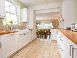 Fully equipped, spacious kitchen with plenty of oak work surfaces & underfloor heating.