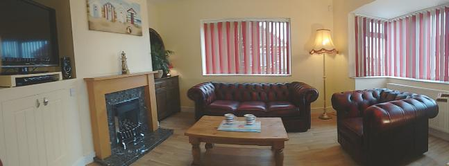 Lounge with leather Chesterfield suite, Gas Fire, Games/DVD cupboard and Wi-Fi connection.