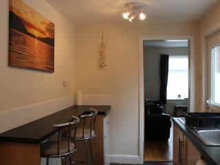 Fully equipped kitchen with breakfast bar and 2 stools.