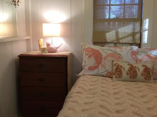 Separate bedroom with new pillow top full-size bed.