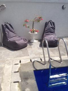 sunbeds parasol and sitsacks around the pool