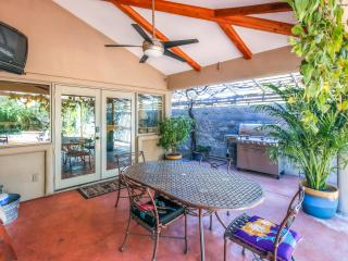 This patio with a grill and pool table is perfect for gathering with your whole group!