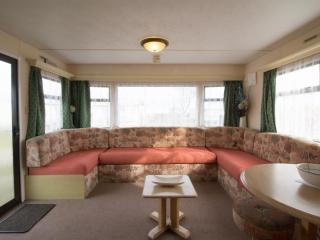Lounge area in this homely caravan book your holiday with us.