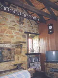The sitting room with fire place and TV & DVD