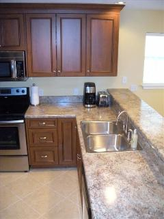 Fully stocked kitchen with dishwaher and garbage disposal