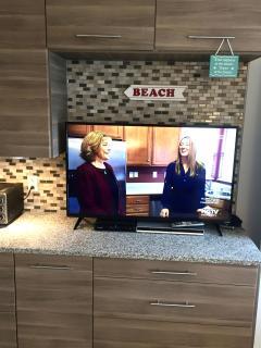55' Hi-def flat screen TV with cable & smart-TV access