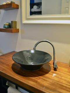 Beautiful vanity made of guanacaste wood with a ceramic sink.