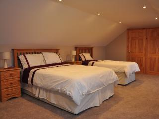 Four luxuriously appointed bedrooms over two floors sleeping eight.
