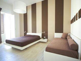 Elegant bedroom with balcony...
