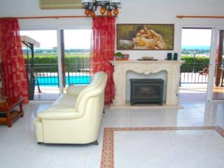 Open plan lounge area with views to sea