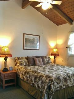 Upstairs king bed with vaulted ceilings