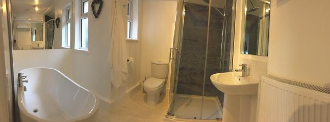 Main bathroom with free standing bath and rainfall shower.