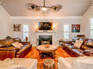 Beautiful leather and lots of seating in family room. Large HDTV, ceiling fan, working fireplace