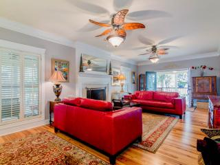 Large GreatRoom. French doors to Wrap Deck. Fireplace. Ceiling Fans. Big HDTV. Lots of seating.