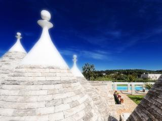 Trulli in a beautiful garden with swimming pool