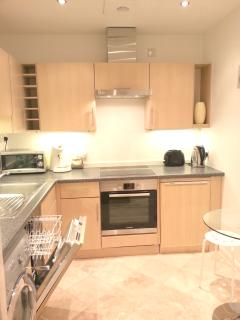 kitchen with t dishwasher, washing machine, dryer, coffee machine, microwave, oven and all equipment