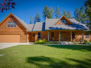15 private acres of lush lawns, wooded forest, serene lakes, accessible trails and fishing