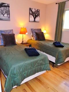Cozy third bedroom has twin beds with new Serta mattresses