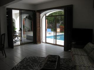 Living room looking out to pool and patio.