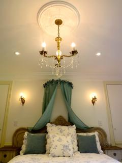 romantic master bedroom with intricate details