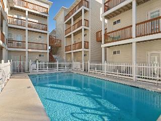 Lovely, oceanfront condo w/ partial views of the water and a shared pool!