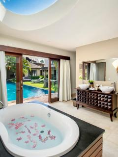 The master bathroom is enclosed with direct access to the pool
