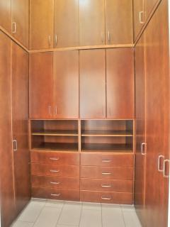 Walking in closet in master bedroom