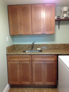 Convenient and spacious full size laundry room right off the kitchen