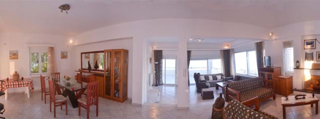 panoramic view of the living rooms and dinning room