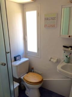 Upstairs bathroom includes shower, toilet and basin.