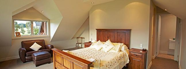 Loft Queen bedroom with log-burner and balcony facing the lake -  ensuite with bath and shower.