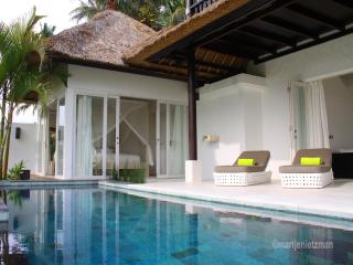 Poolside bedroom with lounge chairs