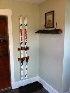 Repurposed skiis and telephone pole as coat/hat/glove racks in the back mud room.